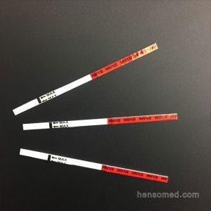 three Anti-HIV 1+2 test strip on black backgroud